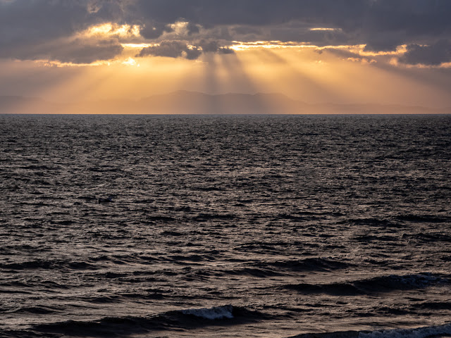 Photo of light breaking through the clouds over the Solway Firth