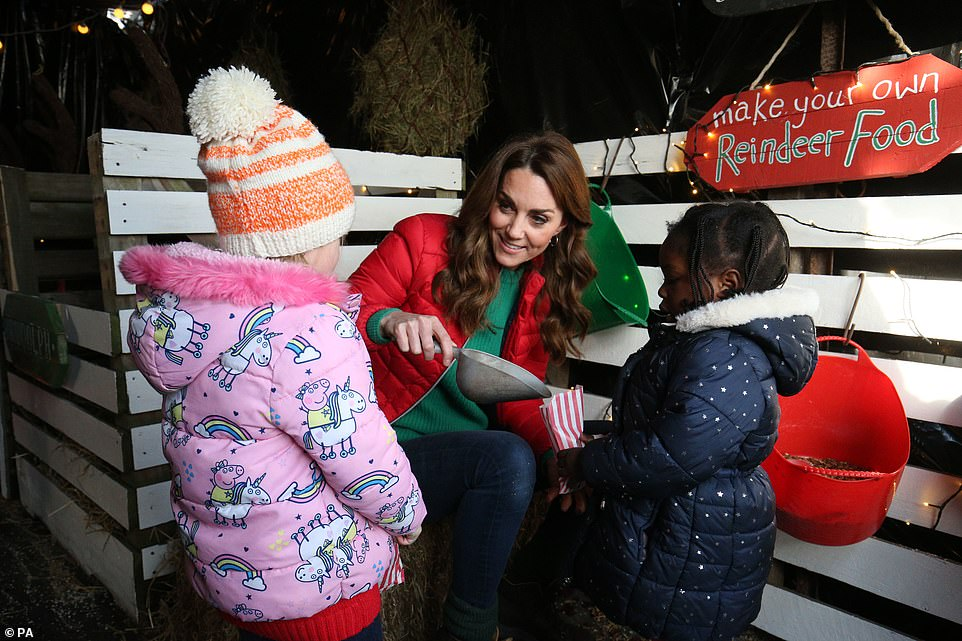 Festive Duchess Kate as she Visits Her New Patronage Family Action Handed Down from The Queen after 65 Years