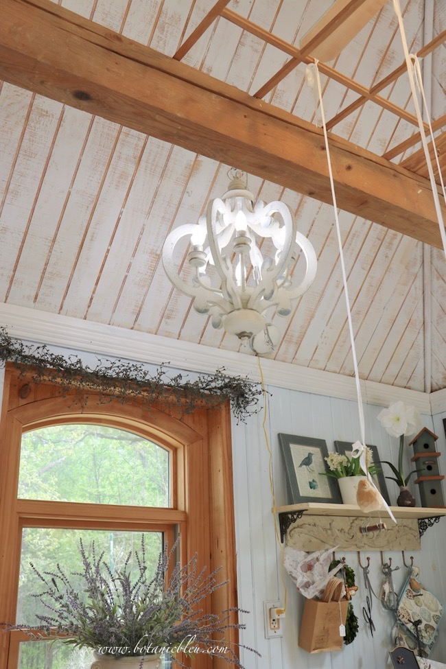 French Country is in the details with a ceiling wood chandelier converted to a plug in light