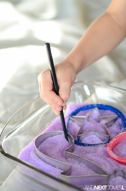 Fine motor sensory activity for kids using lavender scented epsom salt and cookie cutters from And Next Comes L