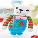 http://www.topcrochetpatterns.com/free-crochet-patterns/gift-card-teddy