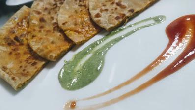 Serving garnished paratha for paneer paratha recipe