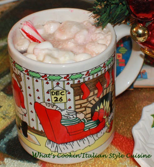 this is a holiday Christmas cup of hot cocoa with a shot of Amaretto and marshmallows on top