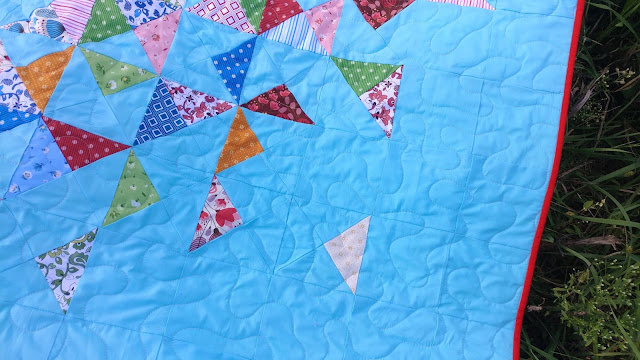 Meander quilting on Exploding Heart quilt made with Morrison Park fabrics