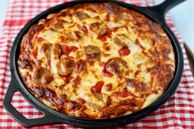 Cheesy Pan Pizza with Turkey Sausage in a cast iron skillet