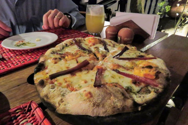 Peru foods: Cured alpaca pizza at Pachapapa in Cusco