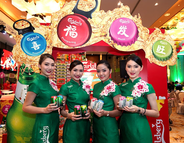 """Carlsberg's CNY campaign """"Prosperity Begins wishes consumers an abundance of Prosperity, Happiness, Wealth and Good Luck in vibrant red, green, pink and blue colours across its limited-edition packaging including bottles and cans."""