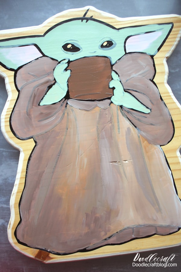 Paint the inside of yoda's ears pink, the robe in shades of brown and the cup dark brown. Don't worry about going over the vinyl lines a little.