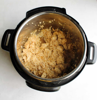 browned chicken and toasted arborio rice in instant pot ready to make risotto