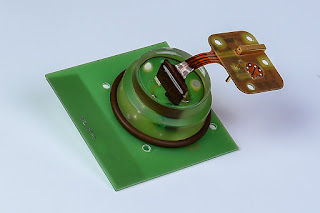 PCB mounted epoxy sealed vacuum feedthrough