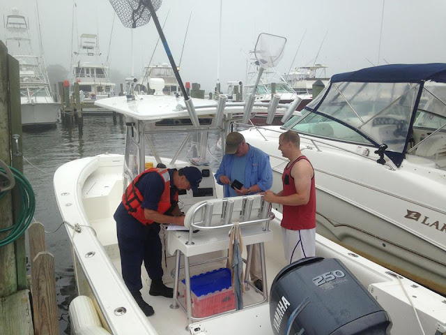 Bill Iwanyk talks to two boaters about their vessel.