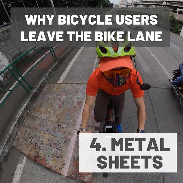 Sharp metal sheets along the bike lanes