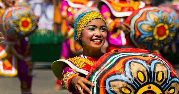 Filipinos dancing at a festival in the Philippines