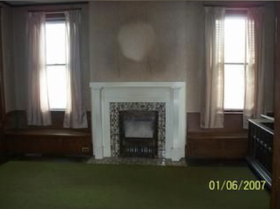 color photo of living room fireplace and two windows, Sears No 137, 40 4th Street, Canisteo, New York