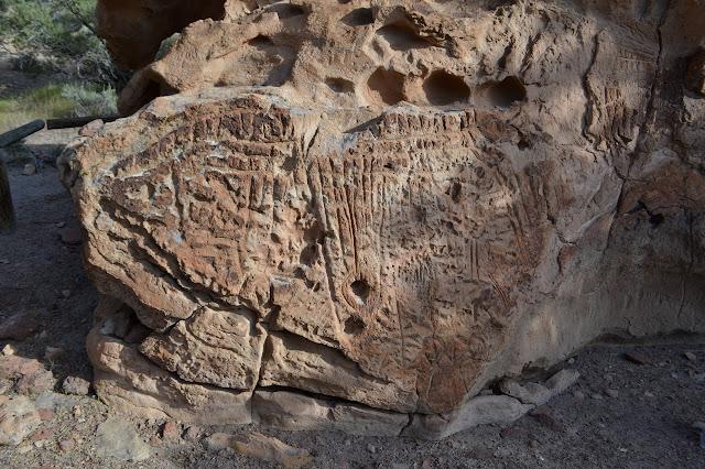 many deep carved elements on desert varnish