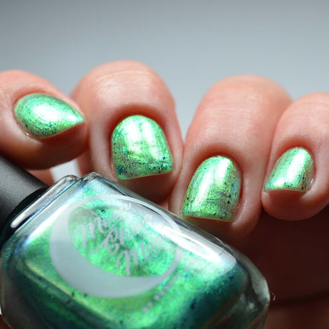 green shimmer nail polish low light swatch