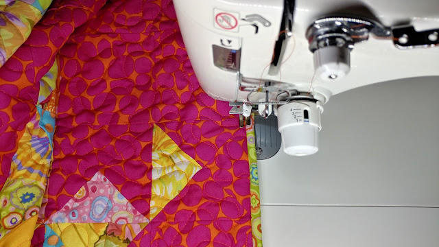 Sewing binding on by machine