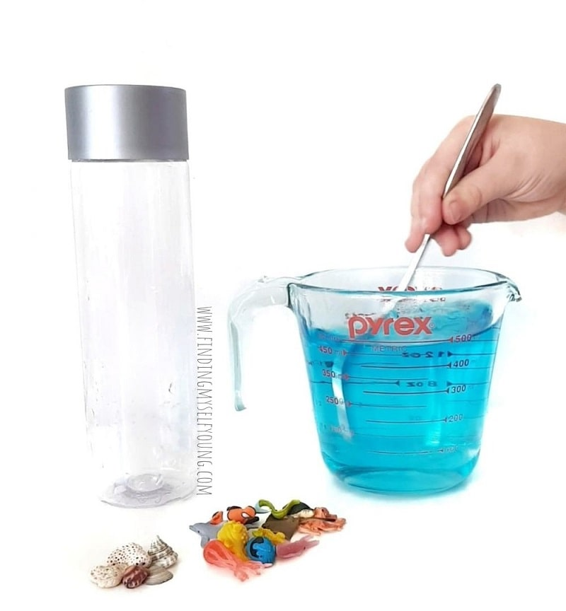 mixing food colouring for a sensory bottle