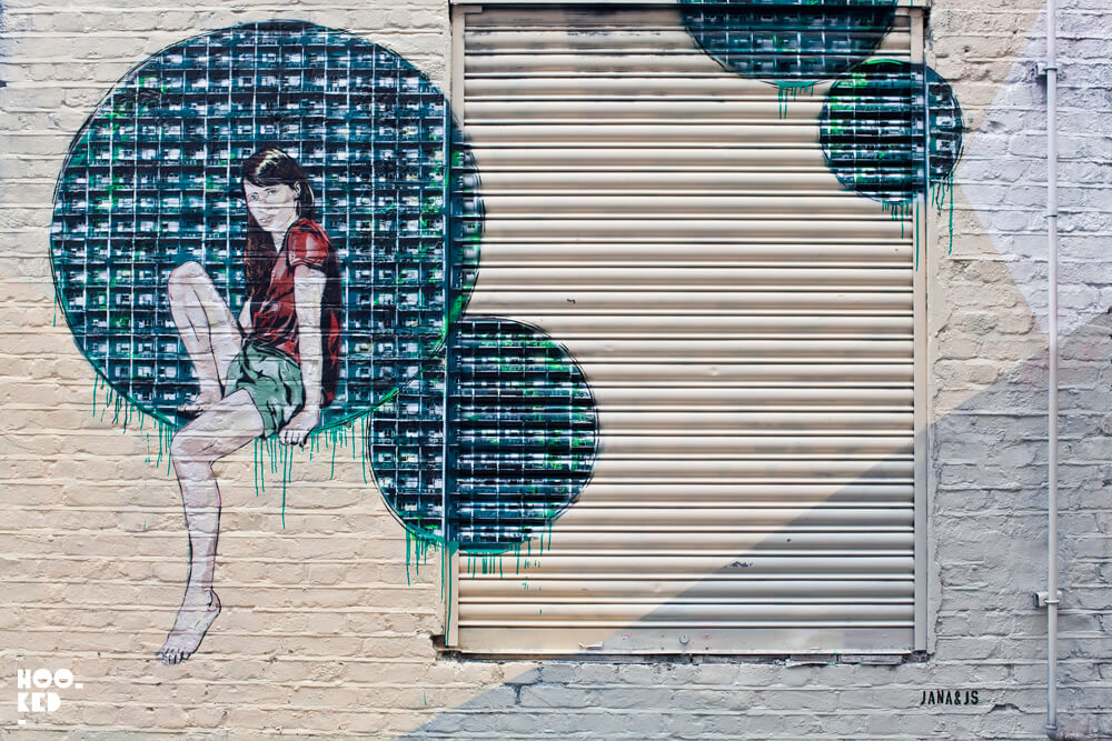 French street artists Jana & JS stencil work on the streets of London