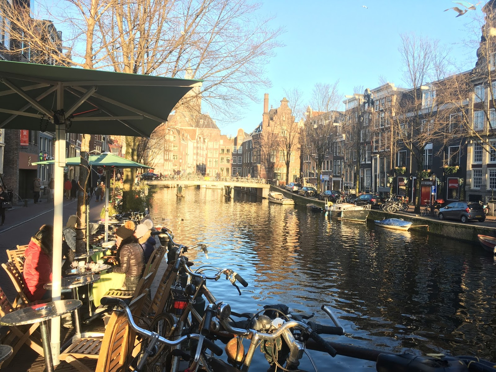 An image of an Amsterdam canal during the day