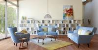 Blue sofa for mid-century living room interior design idea