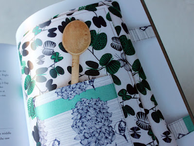 wooden spoon in a pocket on the potluck tote
