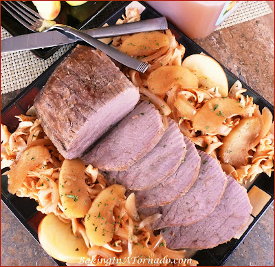 Slow Cooked Apple Cider Beef Roast, a roast slow cooked with onions and apples in a cider based braise. An easy special meal for any night. | Recipe developed by www.BakingInATornado.com | #SlowCooker  #beef #dinner