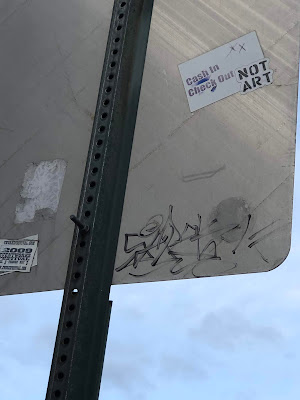 Not Art sticker, Back of traffic sign, close up.