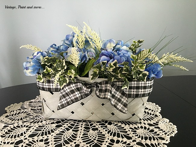 Vintage, Paint and more... spring centerpiece made with upcycled market basket and faux hydrangeas on a vintage crochet doily