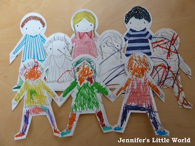 Coloured in Paper Dolls