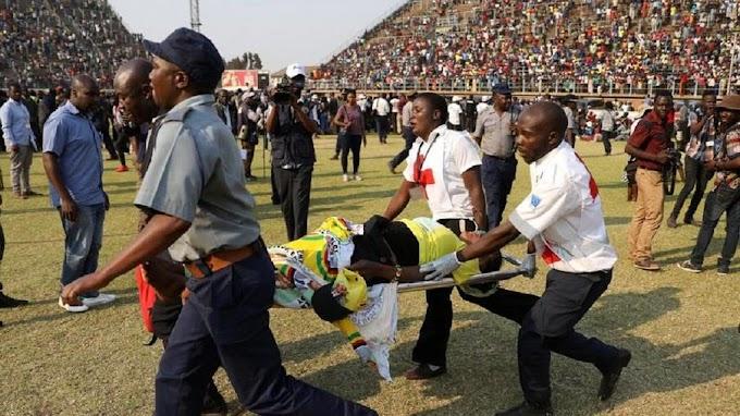 Photos: Stampede, tears as Zimbabweans flock Mugabe's funeral