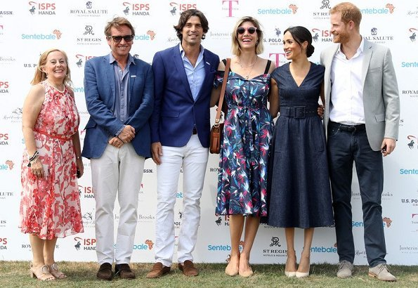 Meghan Markle wore Carolina Herrera dress, Aquazzura 'Deneuve pumps, Birks Bee Chic blue topaz earrings, Tom Ford sunglasses, carries J Crew clutch