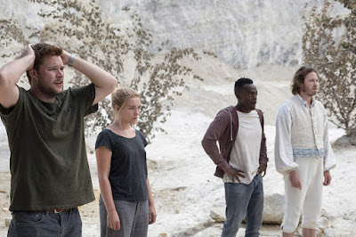 "Florence Pugh, Jack Reynor, William Jackson Harper and Vilhelm Blomgren stand and watch in horror in a movie still for A24's film ""Midsommar"""