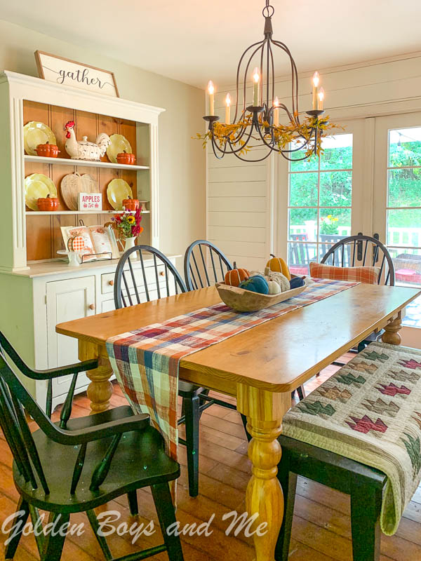 Farmhouse Dining Room with shiplap, Armonk chandelier from Pottery Barn and farm table - www.goldenboysandme.com