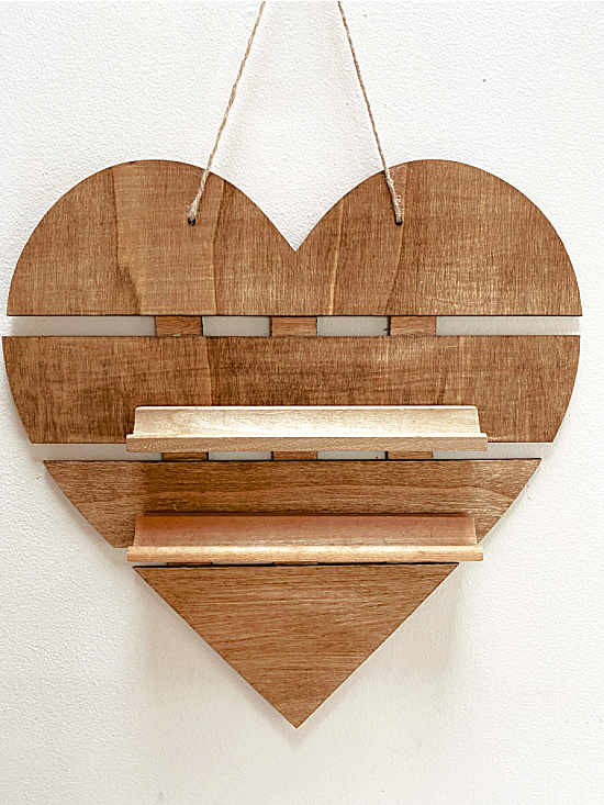 Stained hanging wooden heart with shelves