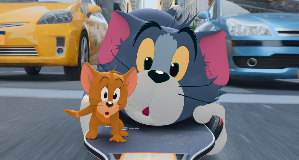 The animated characters Tom, right, and Jerry navigate New York City streets in Tom & Jerry