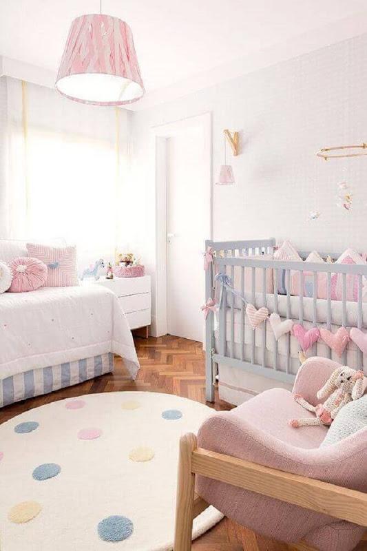 Feminine baby room decor in pastel colors