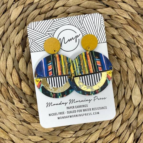 circular patterned paper earrings on display card