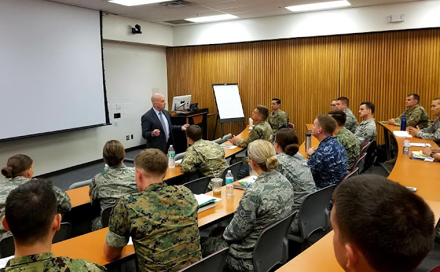 USU President Dr. Richard Thomas welcomes a new class of EMDP2 students to the University.  (Uniformed Services University photo)