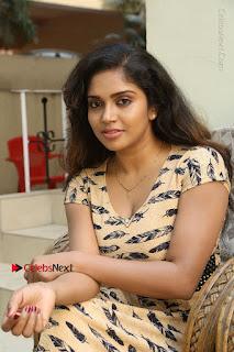 Telugu Actress Karunya Chowdary Stills in Short Dress at ATM Not Working Press Meet  0127.jpg