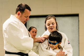 A judo instructor and 2 students | kids judo Ann Arbor