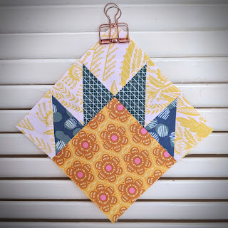 bear paw quilt block hung on slats with metal clip