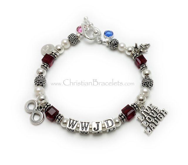 """CB-WWJD-8 This WWJD bracelet is shown with 6 add-on charms: October birthstone, A - Initial Charm, Infinitiy Charm, Live Love Laugh Charm, Angel with Wings Charm and a September Birthstone Crystal. They picked 7 3/4"""" and added a Heart Toggle Clasp."""