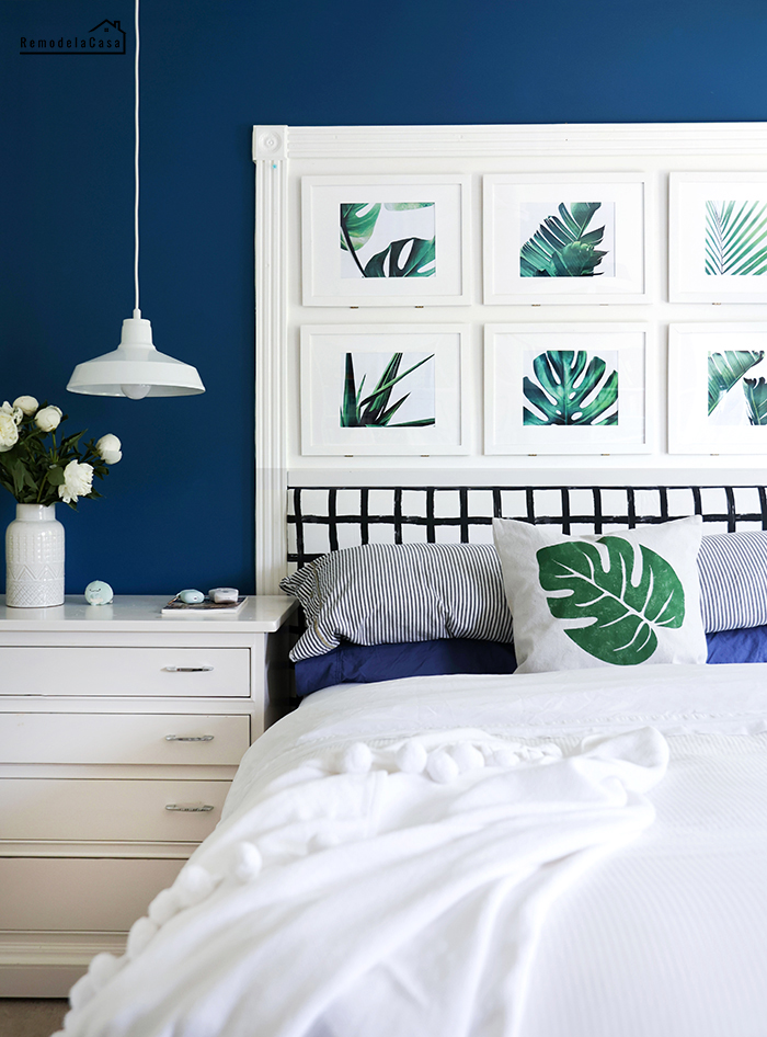 Navy and white bedroom decor with tropical leaf prints
