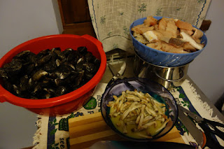 Seafood varieties cut up by cook Riccardo Tuscany Italy