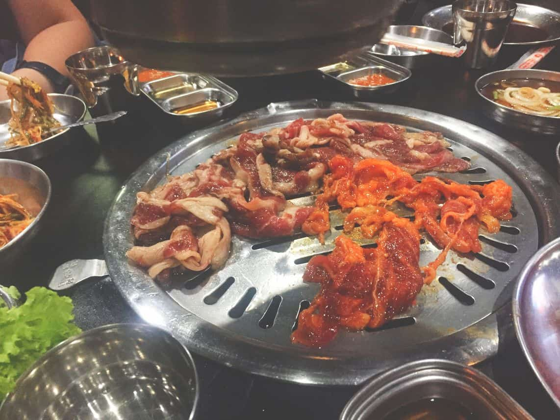 Different kinds of Korean barbecue on the grill at Samgyupsalamat Unlimited Korean Barbecue
