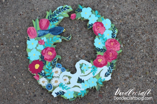 Paint flowers and blue bird on wood cut out wreath for the perfect summertime decor