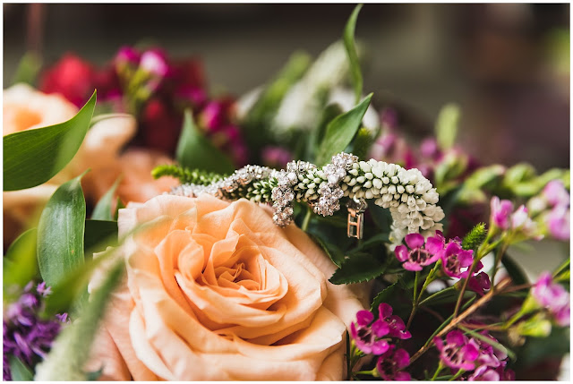 close up photo of wedding bouquet and bracelet