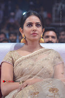 Actress Rakul Preet Singh Stills in Golden Embroidery saree at Rarandoi Veduka Chuddam Audio Launch .COM 0020.jpg
