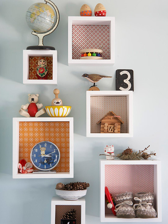 On Another Wall In The Bedroom Wooden Cubbies Are Hung For Displaying Knickknack Items Colorful Fabric Swatches Used As Backing Make Bright Accents